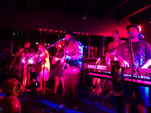Reggae band Guidance Band jams at the Anna O'Briens. HONOLULU, HI - FEBRUARY 21, 2015: Reggae band Guidance Band sings and jams guitars, keyboards on stage at Royalty Free Stock Photography