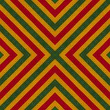Reggae colors crochet knitted style background, top view. Collage with mirror reflection with rhombus. Seamless kaleidoscope monta. Ge for cushion, blanket Royalty Free Stock Photo