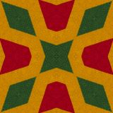 Reggae colors crochet knitted style background, top view. Collage with mirror reflection with rhombus. Seamless kaleidoscope monta. Ge for cushion, blanket stock photo