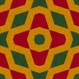 Reggae colors crochet knitted style background, top view. Collage with mirror reflection with rhombus. Seamless kaleidoscope monta. Ge for cushion, blanket Royalty Free Stock Images