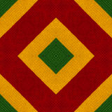 Reggae colors crochet knitted style background, top view. Collage with mirror reflection. Seamless kaleidoscope montage. For cushion, blanket, pillow, plaid Stock Images