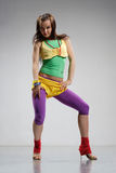 Reggae dancer. Rastafarian style dancer posing on a grey background Stock Photo