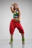 Reggae dancer. Rastafarian style dancer posing on a grey background Stock Photos