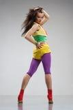 Reggae dancer. Rastafarian style dancer posing on a grey background Royalty Free Stock Photos