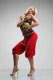 Reggae dancer. Rastafarian style dancer posing on a grey background Stock Photography