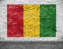Reggae flag painted on  brick wall. Reggae flag painted on white brick wall Stock Image
