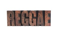 Reggae in letterpress wood type. The word 'reggae' in ink-stained wood letters isolated on white stock photos