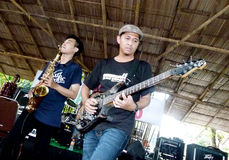 Reggae. Student playing reggae music at a college in the city of Solo, Central Java, Indonesia Stock Photography