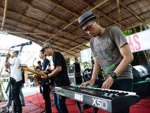 Reggae. Student playing reggae music at a college in the city of Solo, Central Java, Indonesia royalty free stock photos