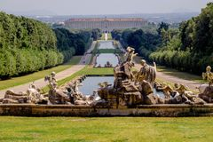 Statues and water bassins in the huge royals gardens of the `Reggia di Caserta` royalty free stock images
