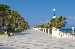 Reggio di Calabria promenade Lungomare Falcomata, Southern Italy. Reggio di Calabria quay waterfront promenade Lungomare Falcomata with view of Strait of Messina stock photos