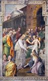 REGGIO EMILIA, ITALIË - APRIL 12, 2018: De fresko Christus en de Vrouw met de Kwestie van Bloed in kerk Basilica Di San Prospero Stock Foto