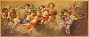 REGGIO EMILIA, ITALY - APRIL 12, 2018: The painting of angels in church Chiesa dei Cappuchini by Padre Angelico da Villarotta. 1900 - 1987 Stock Images