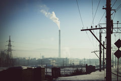 Regime of black sky. Industrial zone in siberian city Royalty Free Stock Image