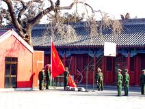 Regimented soldiers raise the Chinese Flag inside the Forbidden City. Beijing, China, January 15, 2015: Regimented soldiers raise the Chinese Flag inside the Stock Photography