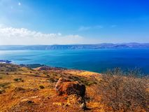 Region in Israel: Jordan Rift Valley, Golan Heights, Galilee. Sea of Galilee Hebrew: Kinneret or Kineret. Beautiful landscape with lake sea, forest and royalty free stock photo