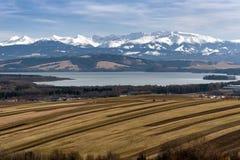 Region Orava, Slovakia. Reservoir Oravska priehrada and High Tatras mountains in region orava, Slovakia stock photo