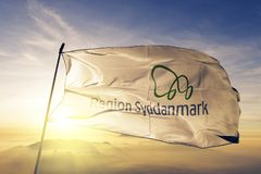 Region of Southern Denmark flag textile cloth fabric waving on the top sunrise mist fog. Beautiful royalty free stock photography
