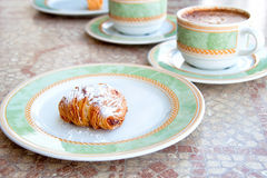 Regional cuisine, Campagnia, southern Italy. Sfogliatelle, a sweet pastry, with Cappuccino coffee. Typical continental breakfast served in Sorrento, Campagnia Stock Photo