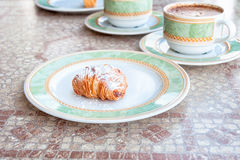 Regional cuisine, Campagnia, southern Italy. Sfogliatelle, a sweet pastry, with Cappuccino coffee. Typical continental breakfast served in Sorrento, Campagnia Stock Photos