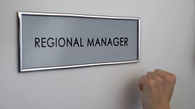 Regional manager office door, hand knocking, business department, company growth. Stock photo royalty free stock images