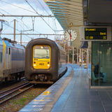 Regional Train in the station Bruges with clock Stock Image