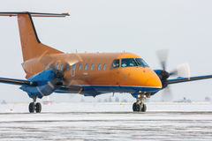 Regional turboprop aircraft. Was taxiing on the runway Royalty Free Stock Photography