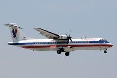Regionales Triebwerkflugzeug des amerikanischen Adlers Lizenzfreies Stockfoto