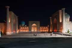 Registan Madrasah illuminated at night stock photography
