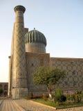 Registan Sher-Dor Madrasah no por do sol 2007 Imagens de Stock