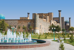 Registan Square. Fountain in front of Ulugbek stock photo