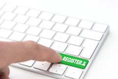 Register. Finger pressing a blue key labeled REGISTER with symbol on a computer keyboard concept Royalty Free Stock Photography