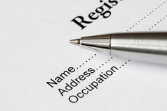Register form. With silver pen for fill empty places Royalty Free Stock Image