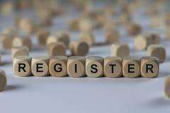 Register - kub med bokstäver, tecken med träkuber arkivfoto