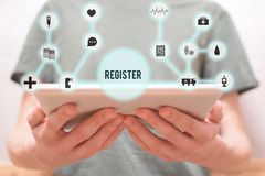 Man holding tablet for registration royalty free stock images