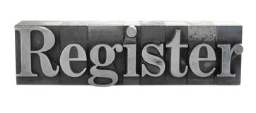 'Register' in metal type. Old, inkstained metal type letters form the word 'Register' in upper and lower case stock photography