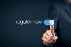 Register now. Businessman switch-on button register now, web registration concept Royalty Free Stock Image
