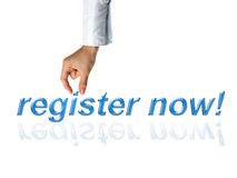 Register now concept with hand and word Stock Images