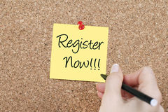Register now. Note on cork Royalty Free Stock Image