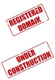 Registered domain & Under construction stamps. Two red stamps: Registered domain & Under construction. Old ruined crate style Royalty Free Stock Images