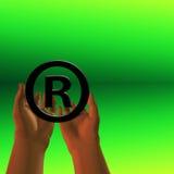 Registered Symbol. Held registered symbol on green Royalty Free Stock Photo