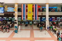 Registering check-in desks with hanged over big Thai flag Royalty Free Stock Photos