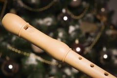 Registrador blanco cerca de un árbol del Año Nuevo Imagen de archivo libre de regalías