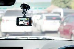Registrador del coche de la cámara del frente del coche DVR en el fondo blanco Imagen de archivo