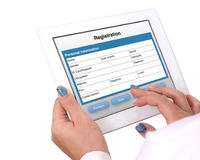 Registration form on tablet computer. Stock Photos