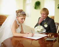 Registration of marriage. Groom in doubt. Royalty Free Stock Image