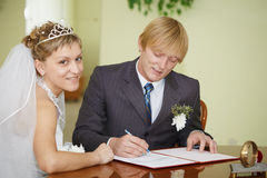 Registration of marriage. Happy newlyweds. Stock Photos