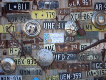 Registration plates and wheel hubs. On a shed wall in Australia royalty free stock photography