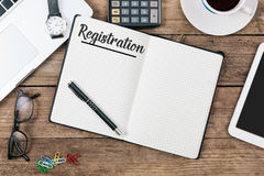 Registration text, office desk with computer technology, high an Royalty Free Stock Photo
