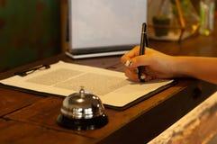 Registrazione di affari dell'hotel fotografia stock libera da diritti